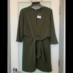 Mini dress with long drapery sleeves. Teal color